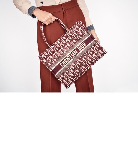 Small Burgundy Dior Oblique Embroidered Dior Book Tote aria_wornViewCropped