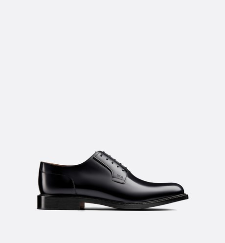 Derby shoe in black calfskin profile view