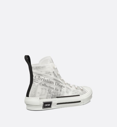 Hoge B23-sneaker DIOR AND DANIEL ARSHAM met Newspaper-motief aria_threeQuarterBackView
